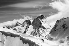 Black and white winter mountains with snow cornice Royalty Free Stock Images