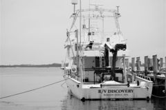 Woods Hole research vessel R/V Discovery. Black and white winter view of R/V Discovery ship in Winter 2019 moored with lines to pier.  Out of Massachusetts, the royalty free stock photo