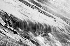 Black and White Wispy Stream Stock Photography