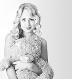 Black and white woman with a teddy bear Stock Image