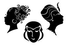 Black and white women`s heads. Black and white silhouettes of a women`s heads royalty free stock image