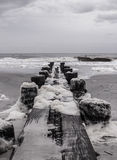Black and white wood pier. On the Atlantic Ocean near Charleston South Carolina Stock Photo