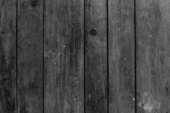 Black and white, wooden background.