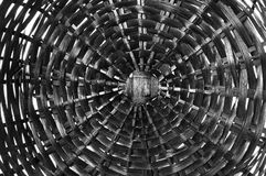 Black-and-white wooden cobweb / texture wicker basket. The bottom of a wooden wicker basket, photographed close-up Royalty Free Stock Photo