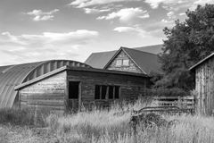 Black and white wooden farm buildings Stock Photo