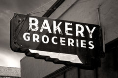 Black and White Worn Bakery and Groceries Sign. In Small Town Royalty Free Stock Photography