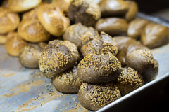 Black wholegrain   bread  with sesame in a tray Stock Photos