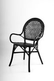 Black wicker chair on a gray background Stock Photos