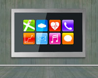 Black wide TV screen with app icons hanging on wall Stock Photos