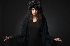 Black Widow. Dark beauty portrait of pale woman Royalty Free Stock Image