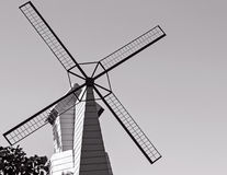 Black windmill. Against on sky in monochrome tone Royalty Free Stock Photos