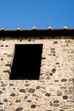 Black Window in Old Stone Wall Stock Images