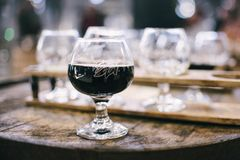 Black Wine in Clear Short Stemmed Wine Glass Stock Images
