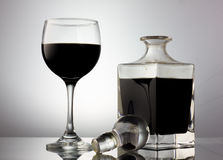 Black wineglass and crystal decanter Royalty Free Stock Images