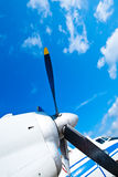 Black wings of an airplane motor in blue sky Stock Images