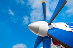 Black wings of an airplane motor in blue sky Stock Image