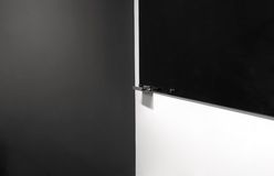 Black Wipe Board on white wall Stock Photos