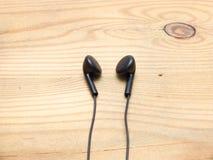 Black wired earphones Stock Photos