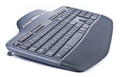 Black Wireless Computer Keyboard. New black wireless computer keyboard isolated on white royalty free stock photo