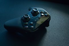 Black Wireless Game Controller on Black Leather Royalty Free Stock Photography