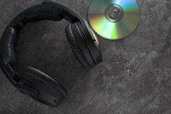 Black Wireless Headphone with Compact Disk Royalty Free Stock Photos
