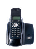 Black wireless phone resting on base. Retro phone stock photo