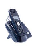 Black wireless phone resting on base. Retro phone stock photos