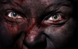 Black witch. Close-up view on evil witch with bloody black skin Royalty Free Stock Photography