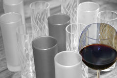 Black and withe and color for some glasses of wine. Photo in black and white of glasses with a fltute of wine at color stock image
