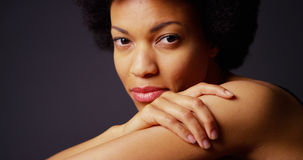 Black woman with afro looking at camera Stock Images