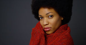 Black woman with afro wearing red shawl Stock Photo