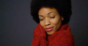 Black woman with afro wearing red shawl Royalty Free Stock Image