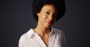 Black woman with afro and white blouse Stock Photography