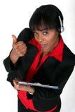 Black woman answering a hotline. Stock Photos