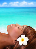 Black woman on the beach. Beautiful black woman lying down with closed eyes on the beach, day spa, summertime vacation stock photography