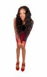 Black woman bending forward. Royalty Free Stock Images