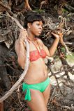Black woman in bikini. Stood by tree branches Stock Photography