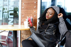 Black Woman in Black Casual Outfit at Coffee Shop Stock Photography
