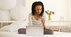 Black woman buying online Stock Photos