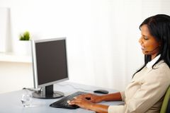 Black woman call operator on work Stock Images