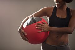 Black woman carrying crossfit ball Royalty Free Stock Image