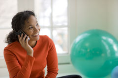 Black woman on cell phone. Smiling beautiful African American woman talking on a cell phone Royalty Free Stock Images