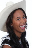 Black woman in a cowboy hat. Laughing African American woman in a white cowboy hat Stock Image