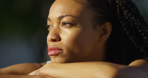 Black woman crying outdoors. Looking away Royalty Free Stock Photo
