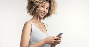 Black woman with curly afro hiar portrait Stock Photos