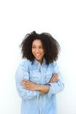 Black woman with curly hair smiling Stock Image