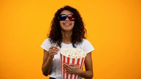 Black woman in 3d glasses eating popcorn and watching comedy movie, leisure. Stock photo royalty free stock image
