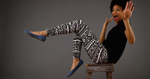 Black woman dancing on chair stock photography