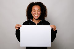 Black woman displaying white banner. Isolated on background stock photos