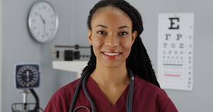 Black woman doctor smiling at camera Royalty Free Stock Photography